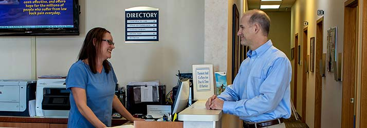 Chiropractor Commerce Township MI Dr. Gary Sclabassi and Staff